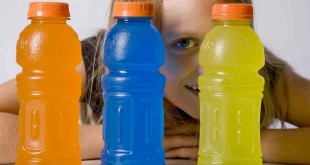 Girl looking through bottles of sports drink