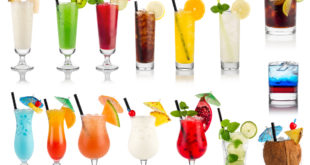 How do acidic beverages affect restorative materials